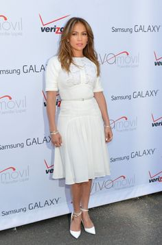 Demure Damsel. J.Lo covered up when she attended the Viva Movil By Jennifer Lopez Flagship Store Opening at Viva Movil in New York City, looking demure in a white, body-hugging dress.