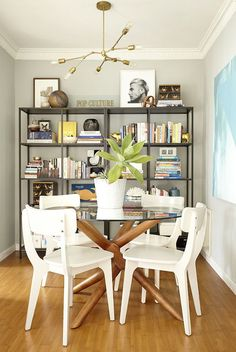The midcentury modern table and chairs make a statement without overpowering the small space.