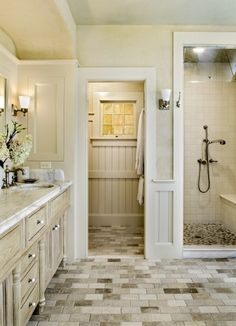 French county bath; don't like floors.  I think it would look great with dark wood floors or tile.