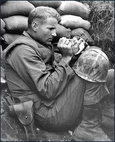 "Photo taken in Korea 1953. The kitten, Miss Hap was only 2 wks old. The  kitten was rescued by Marine Sergeant Frank Praytor.     In 2010, Praytor wrote, ""Miss Hap was weaned on meat out of C rations and grew into a big girl who thought I was her father. When I left Korea, I left her in the care of another Marine. When I returned in '55, she was alive and well.    At 83, I'm still saving orphans. Have two cats, Molly and Max. They never leave the house."""