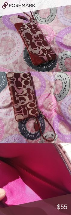 Coach Wristlet Gorgeous used Maroon Classic coach design wristlet. Maroon suede on front corners. Very clean bright pink interior. A little wear on the silver hardwear as pictured, no damage otherwise. Coach Bags Clutches & Wristlets