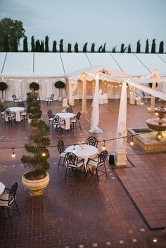 Reception in the courtyard. Classic, elegant and romantic wedding with an architectural backdrop. Grand Island Mansion   Custock Photography   Florals by Visual Impact Designs