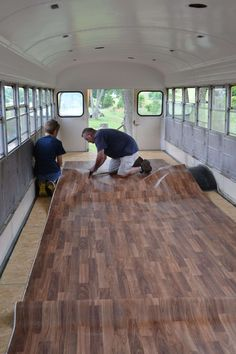 When converting a school bus, there are several options for the flooring. In this bus we choose linoleum that looked like hard wood. It is easy to install. Bus Living, Tiny House Living, School Bus House, School Buses, Bus Remodel, Converted Bus, Short Bus, School Bus Conversion, Camper Conversion