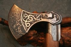 The axe was the main hand weapon for all Vikings since swords were very expensive. The typical Viking always had this weapon at all times on the battlefield, or used as a tool at home. Vikings, Viking Axe, Beil, Battle Axe, Medieval Weapons, Fantasy Weapons, Knives And Swords, Oeuvre D'art, Blacksmithing