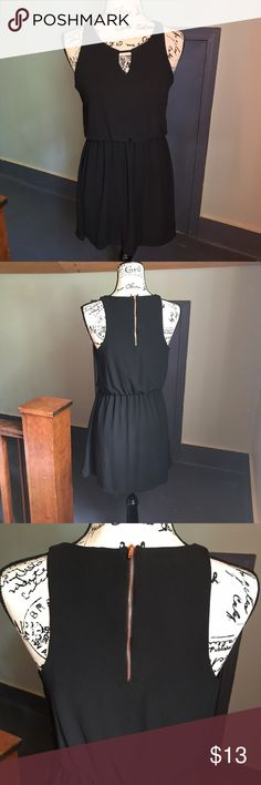 Gorgeous Black Dress with Keyhole Detail Gorgeous black dress from Target with keyhole detail on the front and working rose gold zipper on the back. Has an elastic waistband to accentuate your figure. Comes from a smoke free home. Xhilaration Dresses