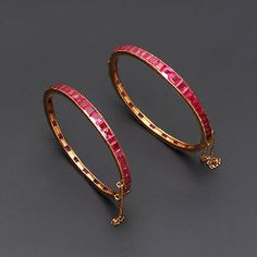 A PAIR OF RUBY BANGLES\nEach hinged bangle set with graduated calibr-cut rubies, contemporary, inner diameter\nNot illustrated 24k Gold Jewelry, Ruby Jewelry, Jewlery, Fine Jewelry, Jewelry Making, Gold Bangles Design, Gold Jewellery Design, Antique Jewellery, Ruby Bangles