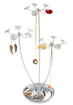 I think the best part of this Growing Collection Jewelry Stand is that the flowers have holes to put studs or dangles in them.