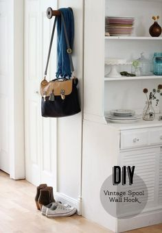 20 DIY Projects You Can Make for Under $10: vintage spool wall hook. should always try use industrial stuff for this