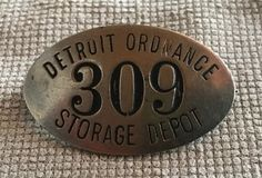 During WWII, Detroit had Ordnance depots specifically for tanks (Tank Arsenal) and vehicles (Fort Wayne). Smaller supply items like ammunition, helmets, replacement parts were stored at the Detroit Ordnance Warehouse in NW Detroit. #arsenalofdemocracy #detroithistory #badge #employeebadge
