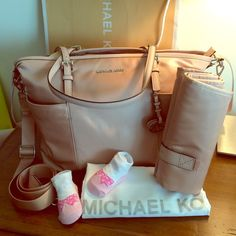 """Michael Kors Diaper BABY BAG Jet Set Blush NWT! Gorgeous 100% Authentic diaper bag. Blush color combined with silver hardware.  Comes with changing pad. Paper work and tags are attached.  Perfect new condition.  Long strap is adjustable and detachable as well.  Measurements: L16.5""""/ H11.5"""" Handles: 10"""" Drop Strap: 14""""/22""""  Material Pale Pink/Blush color  Retail price: $298 Michael Kors Bags Shoulder Bags"""