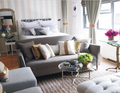 """Love this but maybe a """"wall"""" Or some kind of shelving unit in between the bed and living area. Nate Berkus decorated this studio apartment. Sofa at the foot of the bed, round cocktail table. Tiny Studio Apartments, Studio Apartment Layout, Studio Layout, Design Apartment, Apartment Living, Apartment Sofa, Apartment Ideas, Bachelor Apartment Decor, Apartment Checklist"""