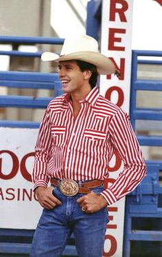 Lane Frost is so attractive! He is from my favorite movie 8 Seconds!!! He is a professional bull rider!! <3 <3 That's a real cowboy ^^