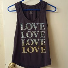 Love love love muscle tank by American Eagle! Cute tank top with fun lettered print! American Eagle Outfitters Tops Tank Tops