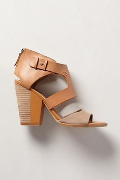 Cute two-tone thing going on in this heels which happen to have a lovely shape design too.