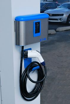 A solar charging station that's free to the public. Awfully tempting to trade in the gas-guzzler. Ev Charger, Electric Car Charger, Electric Cars, Solar Charging Station, Car Charging Stations, Chevy, Illinois, Car Station, E Mobility