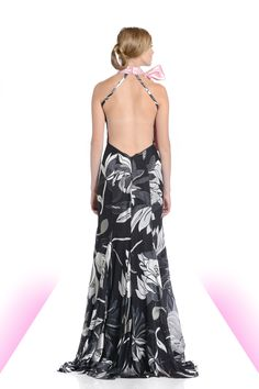 Magnolia burnt chiffon halter gown with double faced pink bow, high front slit, and low back with support straps.   #magnolia #fashion #eveningwear #highslit #lowback #pink #bows #print #chiffon
