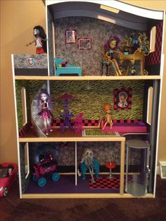 I turned my daughters old Barbie House into a Monster High house with scrapbook paper!