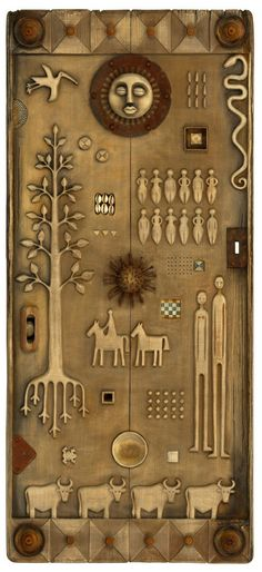 Tribal Story Door - Medium: wood carving. Materials: wood, found objects, rusty metal. Dimensions: 140cm x 65cm.