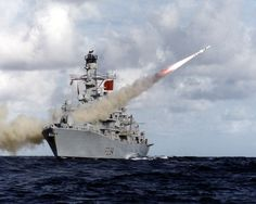 Type 23 frigate HMS Iron Duke is pictured firing her Harpoon anti-ship missile system.