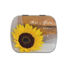 The shabby chic Sunflower and Veil Country Wedding Favor Candy Tin is filled with delicious Jelly Belly Candies! Feel free to choose your favorite flavor of jelly beans or mints! This charming custom country wedding #favor features a quaint floral photograph of a yellow #sunflower blossom and white bridal veil with a weathered brown barn wood background. Perfect for a rural #country farm, #rustic barn, ranch or western #wedding theme. #weddingfavors