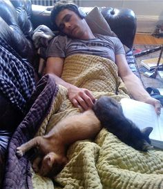 James Franco cuddling with cats... I am in love