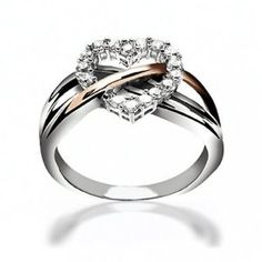 heart wedding ring this is creative and pretty wedding ring and I would love to have this ring just as a ring but not my wedding one im still trying to find my perf one!!! <3