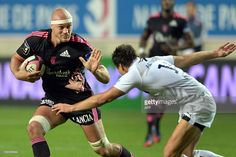 Stade Francais' flanker Scott Lavalla vies with Montpellier's scrumhalf François Trinh Duc during...