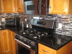 glass backsplash and granite galaxy granite countertop and black glass tile backsplash