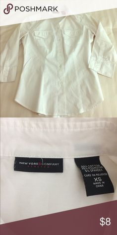 New York & Company button up white shirt Stretch white shirt by New York & Company. 60% Cotton, 30% polyester, 10% spandex. Size: XS New York & Company Tops Button Down Shirts