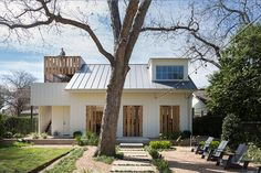 In the historic Texas neighborhood of Old West Austin, clients asked architect Tim Cuppett to add sleeping quarters to a one-bedroom house (circa 1908). To avoid disfiguring the facade with an attic dormer (or worse), Cuppett came up with a charming solution: the back alley house.