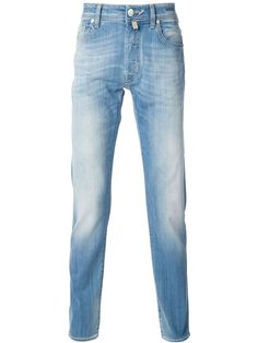 Blue stretch cotton faded jeans from Jacob Cohen featuring belt loops, a button and zip fly, a five pocket design, a leather brand patch to the rear and turn up hems.