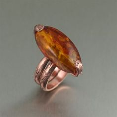 Handmade Bark Copper Ring with Amber - Earthy and chic, this tree branch design combined with the rich rose-gold look of copper is highlighted with a large honey Amber gemstone. For a chic and timeless look, you can't go wrong with this one-of-a-kind copper ring.