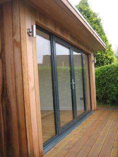 Sanctum Garden Studios have recently completed this bespoke two room garden studio, with cedar clad external door and deck area. Interior And Exterior, Outside Living, Yoga Studio Home, Backyard Office, Garden Studio, Summer House, Garden Buildings, Small House, Modern Shed