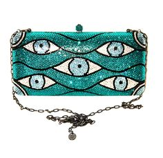 View this item and discover similar for sale at - This lovely clutch features a removable silver-tone chain strap, an all-over eye motif, a push clasp fastening on top and comes with a matching Swarovski White Leather Handbags, Blue Handbags, Leather Clutch, Leather Purses, White Clutch, White Handbag, Blue Purse, White Purses, Tiffany Blue