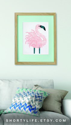 Turn your living room into a tropical haven with a pink flamingo wall art print.