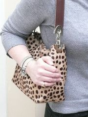 Cowhide Bags.  Practical and funky.  We love this and it comes in various designs.