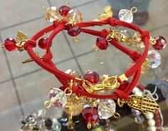 beaded charm bracelet with suede cord and glass beads