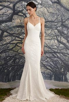 Nicole Miller. Mermaid gown made of floral corded lace. Scalloped open V-back with crisscross slim straps.