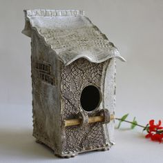 birdhouse. love the different textures on each wall and the wood perch.