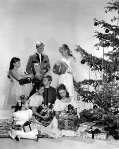 The Von Trapp kids opening their Christmas presents