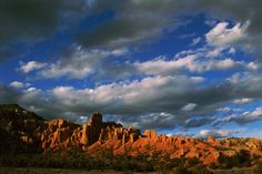 size: Photographic Print: Warm Sunlight Washes over the Landscape of Cliffs in Utah by Barry Tessman : Artists Nature Posters, Sunlight, Monument Valley, Canvas Wall Art, Clouds, Warm, Mountains, Art Prints, Landscape Posters