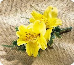 Yellow Alstroemeria decorated with just the right touch of greens on this charming Boutonniere.