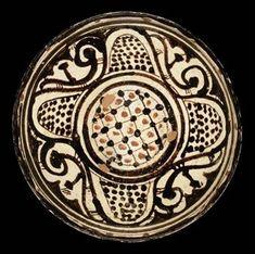 A SMALL NISHAPUR SLIP PAINTED POTTERY BOWL, IRAN, 10TH CENTURY