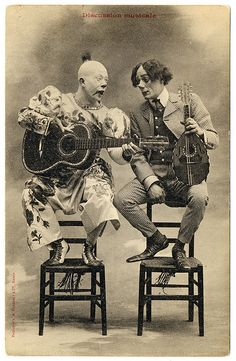 Clown Talk (c.1905)    Discussion musicale    Vintage photographic postcard, c.1905, uncirculated, divided back, published by A. Bergeret & Cie, Nancy, France.