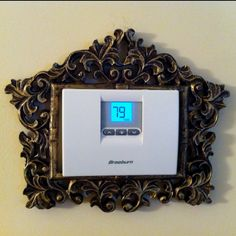 Super Quick DIY: picture frame ($6) around a thermostat. Love it! My husband wasn't enthused about it either... men! Idea from http://allthingshomie.blogspot.com/2011/09/embellishing-life.html