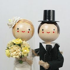 a long gallery of cute wedding cake toppers