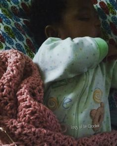This is how I spend my Friday evening...crocheting and grandma time. #imskylarsmimi#locsofluvcrochet  #sleepingbaby#pinkcowl#stockinginventory#fall/winter#sheistoocute by locsofcrochet