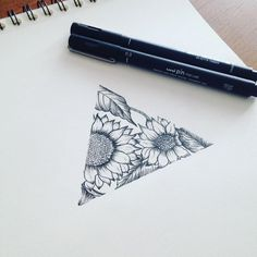 Not sunflowers, but I like the idea of a partial image #geometrictattoos