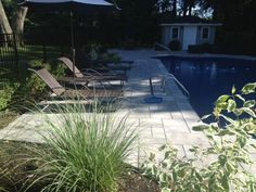 This is a beautiful zen outdoor living space. This pool patio features Cambridge Pavingstones with ArmorTec.