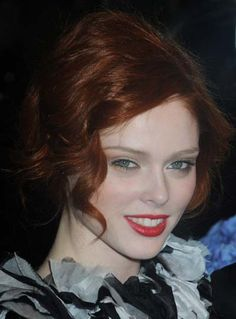 Coco Rochas fiery red elegant updo hairstyle